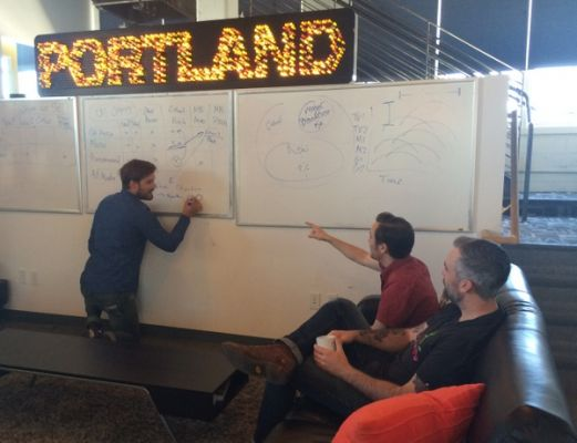 Paul Anthony and clients brainstorm at Rumblefish HQ