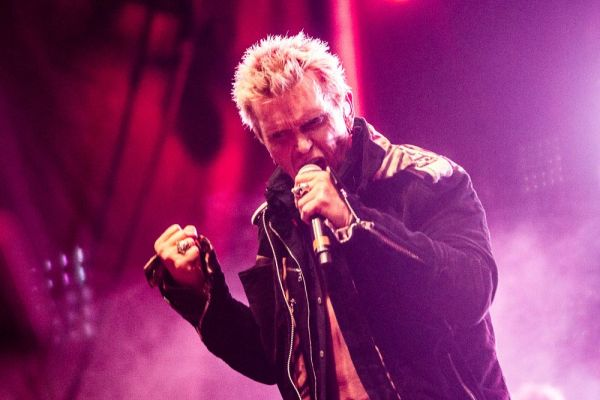 Billy Idol, still striking the familiar poses.